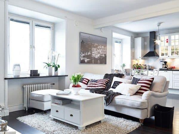 современная гостиная, совмещенная с кухней, в скандинавском стиле